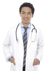 handsome young doctor, smiling at camera