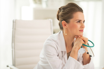Portrait of doctor woman with stethoscope in office