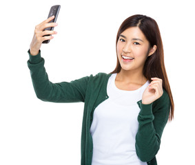 Woman take selfie by cellphone