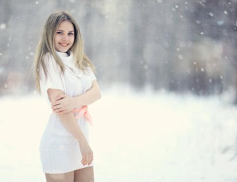 blonde in white dress snow high key