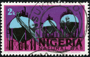 stamp printed in Nigeria featuring natural gas storage tanks