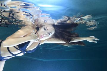 Portrait of beautiful woman underwater