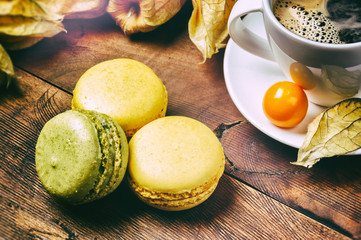 Cup of black coffee with French macaroons