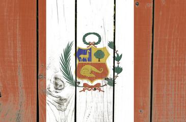 Peru flag on wooden background