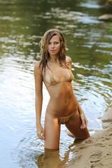 Wet amazing woman in bikini