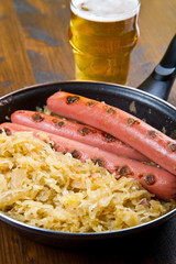 roasted wurstel with  sauerkraft and beer