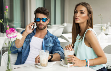 Beautiful woman in cafe with handsome man