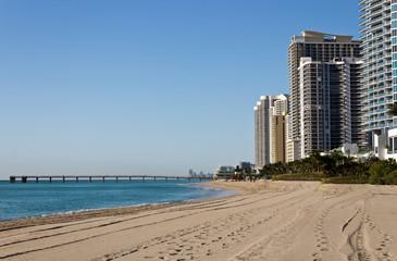 Skyline and pier along the beach of Sunny Isles Beach, Florida