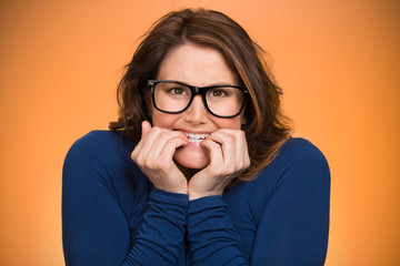Anxious insecure woman, isolated on orange background