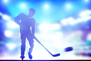 Hockey player shooting on goal in arena night lights