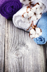 Branch of ripe cotton bolls on multicolor bath towels