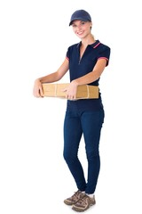 Happy delivery woman holding cardboard box