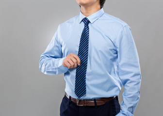 Businessman hand hold with necktie