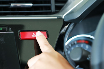 Business woman push emergency button in car