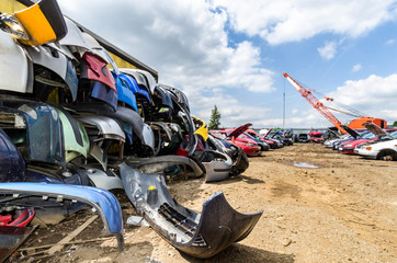 Car bumpers in a pile at scrapyard