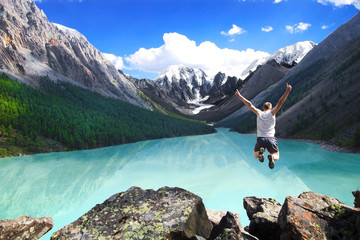 Beautiful mountain landscape with the lake and the jumping man Wall mural