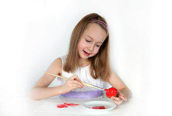 Little girl colouring and demonstrating Easter egg