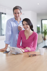 cheerful couple at  home using digital tablet