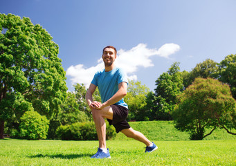 smiling man stretching outdoors