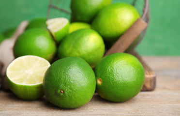 Fresh juicy limes on old wooden background