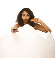 young african american teen with remote and hamburger isolated