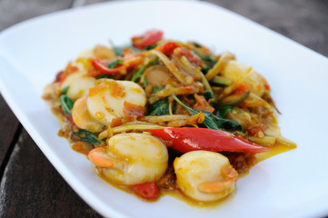 Fried herbal vegetables with hotate, Spicy Thai food.