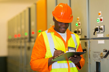 african electrical engineer in control room
