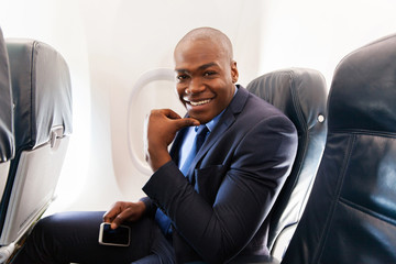 young african american businessman on airplane