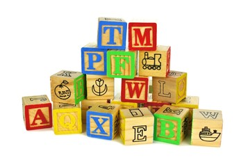 Pile of colorful toy wooden block letters