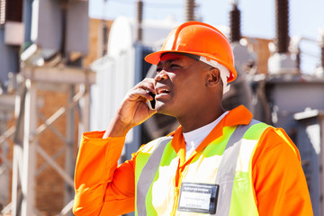 african electrical engineer using cell phone