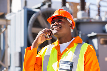afro american electrical engineer talking on smart phone
