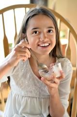 Hispanic Girl Eats Ice Cream