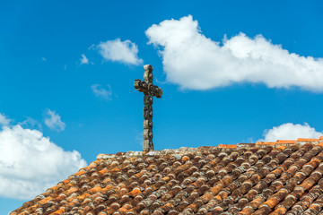 Cross and Tiled Roof