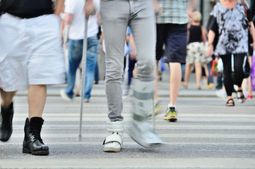 Person with cane crossing street