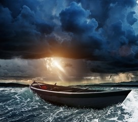 Printed kitchen splashbacks Storm Wooden boat in a stormy sea