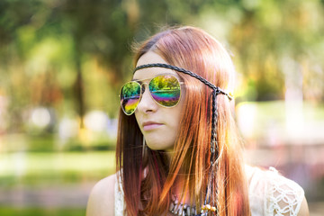 Portrait of hippie style woman in summer sunny day, outdoor.