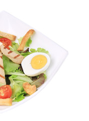 Caesar salad with eggs.