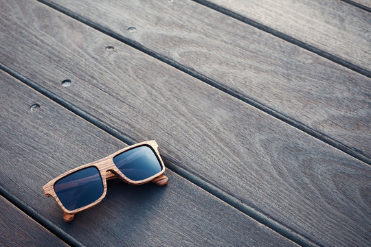 wooden sunglasses and wooden floor