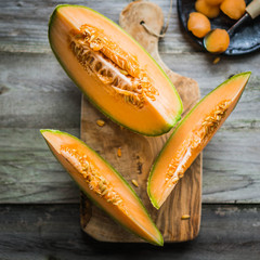 Sliced melon on wooden background