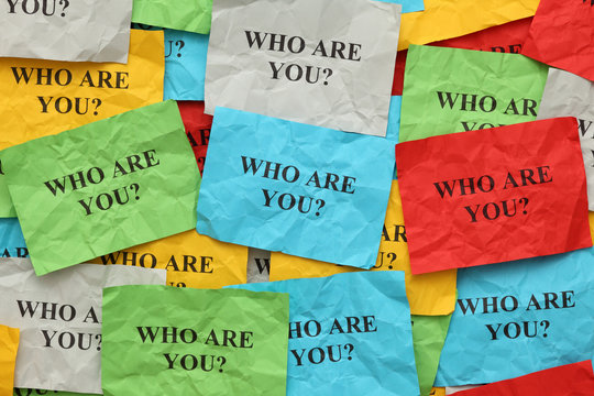 "Crumpled colorful paper notes with the question ""Who are you?"""