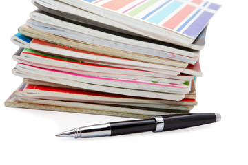 Pile of writing-books with  pen isolated on white background
