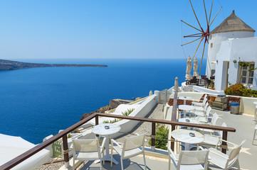 Windmill And Beautiful View In Santorini