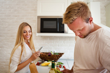 Portrait of happy young couple at the kitchen