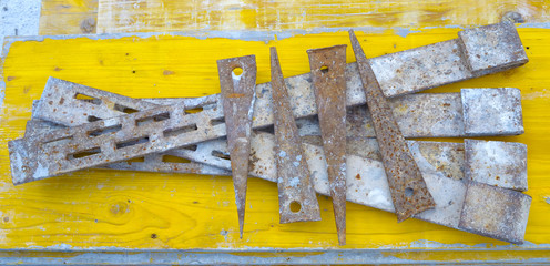 rusty and dirty iron wedges used on a construction site
