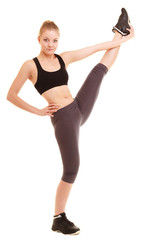 sport. fitness sporty blonde girl stretching leg isolated