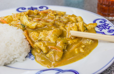 Chinese chicken in peanut sauce, served with rice