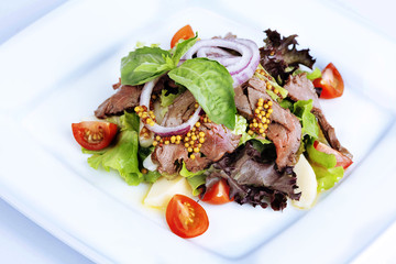 salad with boiled pork, cherry tomatoes, mustard grains