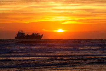 ship silhouette on North sea at sunset