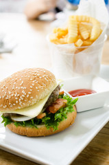 Closeup of home made burgers on table background