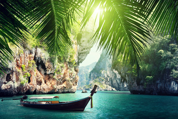 long boat and rocks on beach in Krabi, Thailand Wall mural
